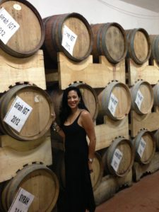 Woman in front of Wine Barrels
