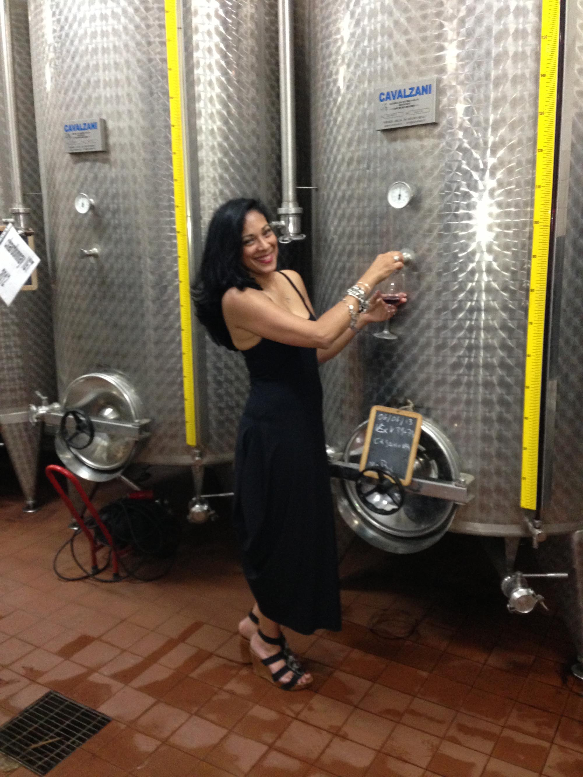 Woman in front of Wine Vats