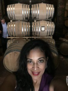 Selfie of a Woman with Wine Barrels